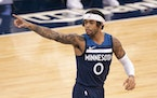Minnesota Timberwolves guard D'Angelo Russell (0) pointed to a teammate after hitting a three point shot in the first quarter against Orlando. ] JEF