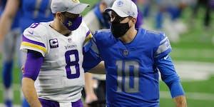 Vikings quarterback Kirk Cousins, left, and Detroit Lions quarterback David Blough walk off the field after season finale on Jan. 3.