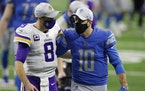 Minnesota Vikings quarterback Kirk Cousins (8) and Detroit Lions quarterback David Blough (10) walk off the field after their NFL football game, Sunda