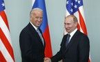 FILE - In this March 10, 2011, file photo, then-Vice President Joe Biden, left, shakes hands with Russian Prime Minister Vladimir Putin in Moscow, Rus