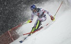 France's Clement Noel speeds down the course during an alpine ski, men's World Cup slalom, in Schladming, Austria, Tuesday, Jan. 26, 2021. (AP Pho