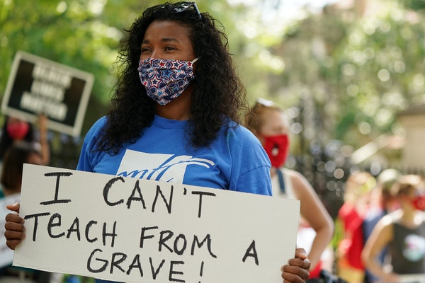 Lindsey West, who teaches fifth grade at Clara Barton Open School, and others protested in-person learning in the fall.