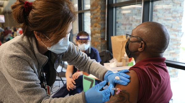 A COVID-19 vaccine is given in Mountain View, Calif., on Jan. 22.