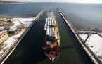 A ship carrying a cargo of wind turbine tower segments pulls into the Duluth Harbor in November.