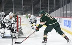 Minnesota Wild left wing Zach Parise tried to set up an assist in the first period which was broken up by Los Angeles Kings defenseman Kurtis MacDermi