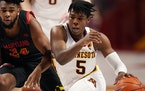 With opponents ganging up on him to stop him from scoring, Gophers junior guard Marcus Carr must look for more ways to involve his teammates in the of