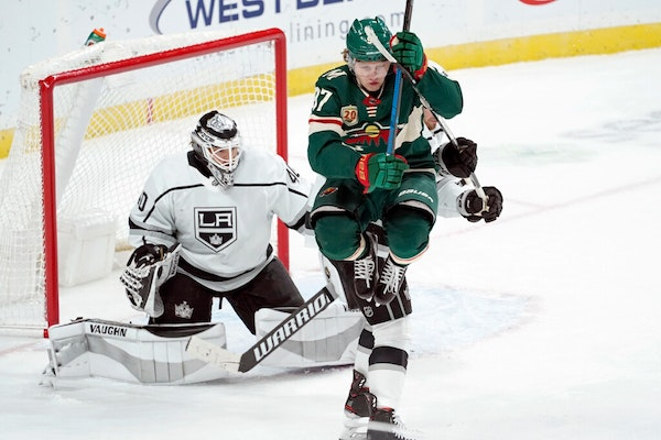 Wild rookie Kirill Kaprizov jumped to clear the way for a shot against Kings goalie Calvin Petersen in the third period Tuesday night. The Kings won 2