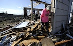 Patti Herring sobs over the remains of her tornado-ravaged home in Fultondale, Ala., on Tuesday, Jan. 26, 2021. Herring and her husband Tim survived b