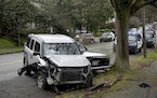 A wrecked vehicle is seen after a driver struck and injured at least five people over a 20-block stretch of Southeast Portland, Ore., before crashing