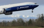 FILE - In this Jan. 25, 2020, file photo a Boeing 777X airplane takes off on its first flight with the Olympic Mountains in the background at Paine Fi