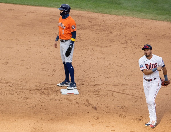 Carlos Correa reached second base on a throwing error by shortstop Jorge Polanco in the ninth inning of Game 1 of the Twins playoff series with the As