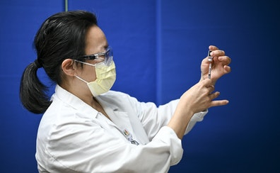 Dr. Sophia Kim, an internist at North Memorial, drew a dose of the Pfizer BioNTech COVID-19 vaccine with a syringe earlier this month.