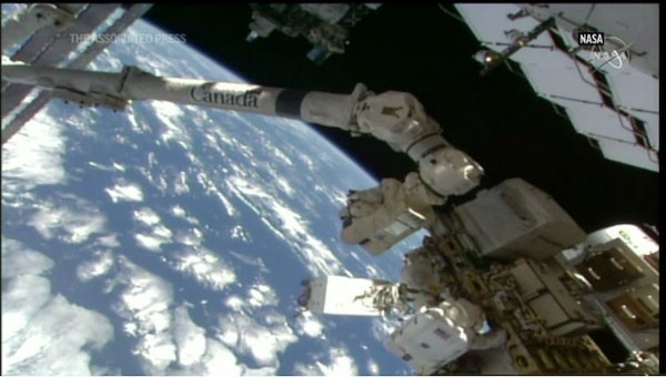 NASA astronauts conduct spacewalk to upgrade Space Station