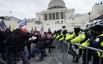 Trump supporters tried to break through a police barrier at the Capitol in Washington on Jan. 6.