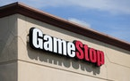 A GameStop store is seen in St. Louis. Two hedge funds are bowing out of their short positions on the money-losing video game retailer.