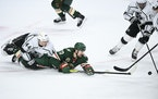 Kings defenseman Mikey Anderson (44) tangled with Wild winger Marcus Foligno on Tuesday.