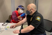 St. Paul Police Chief Todd Axtell received his first dose of the Moderna vaccine Wednesday along with other members of his department.