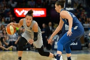 Las Vegas Aces guard Kayla McBride (21) moved the ball against Minnesota Lynx forward Cecilia Zandalasini (9)