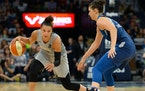 Las Vegas Aces guard Kayla McBride (21) moved the ball against Minnesota Lynx forward Cecilia Zandalasini (9)