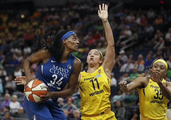Sylvia Fowles of the Lynx shot over Indiana's Natalie Achonwa during a 2018 game at Target Center.