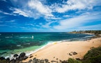 Hookipa Beach, in Paia, Maui, is a hotspot for surfers and turtles, who tend to congregate in distinct areas.