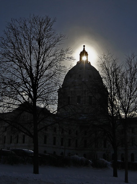 """An extremely cold January day in 2014 produced a """"sun dog"""" phenomenon, making for a dramatic backdrop for the State Capitol in St. Paul."""