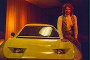"Elizabeth Carmichael, shown with her Dale automobile in ""The Lady and the Dale."""