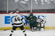 Kevin Fiala of the Wild drove Kings defenseman Matt Roy into the boards Thursday night at Xcel Energy Center. Fiala got a boarding major and was eject
