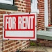 Red For Rent sign closeup against brick building. (Credit: Getty Images/iStockphoto) ORG XMIT: MIN1801191410370364