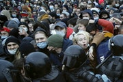 People clash with police on Jan. 23 during a protest against the jailing of opposition leader Alexei Navalny in St. Petersburg, Russia.