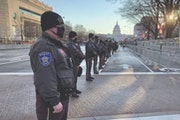 Deputies from the Anoka County Sheriff's Office stood on watch on Pennsylvania Avenue during the inauguration Jan. 20, 2021 in Washington.