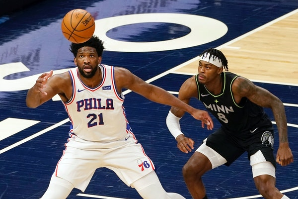 Philadelphia 76ers' Joel Embiid waits for a pass as the Timberwolves' Jarred Vanderbilt defends during the first half