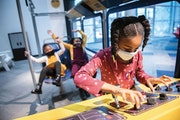 The Minnesota Children's Museum in St. Paul has worked to adapt its mission and services to the pandemic. Here, young visitors take an imaginary b