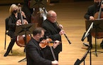 Minnesota Orchestra oboist John Snow and violinist Peter McGuire took the lead in Bach's Concerto in C minor for Oboe, Violin and String Orchestra d