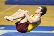Colton Dee competed in the floor exercise Saturday night against Iowa.