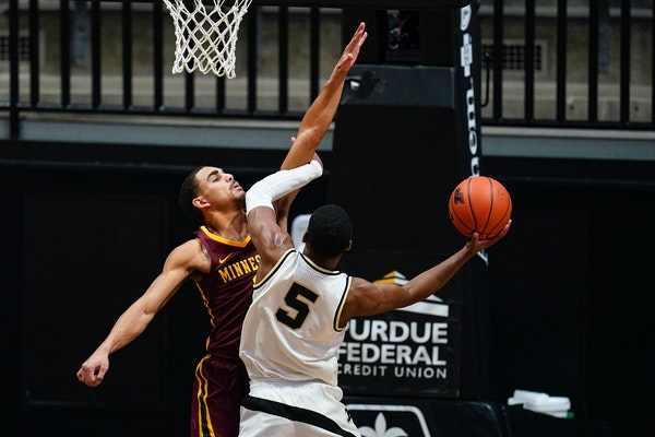 Purdue guard Brandon Newman shoots over Gophers guard Tre' Williams during the first half Saturday.