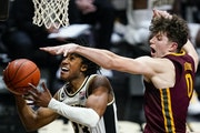 Purdue guard Jaden Ivey was fouled by Gophers center Liam Robbins in the second half. After leading by five points at halftime, the Gophers lost by 19