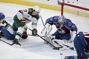Colorado goalie Philipp Grubauer stopped a shot by Wild winger Marcus Foligno (17) on Saturday.