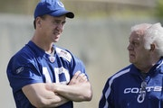 Tom Moore, right, with Colts quarterback Peyton Manning at a Super Bowl practice in 2010.