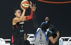 Las Vegas Aces guard Kayla McBride, left, got past Lynx guard Odyssey Sims during a game Sept. 10 in Bradenton, Fla.