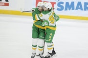 There was no social distancing when Wild players Victor Rask, left, and Kirill Kaprizov celebrated a goal Sunday night.