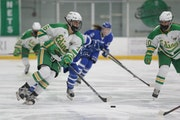 Edina's Emma Conner (16) carries the puck into the offensive zone against Minnetonka Tuesday night. Conner had a goal in the Hornets' 3-2 victory