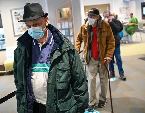 Patients, including Gerald Sweeney, 79, waited in line to be vaccinated at North Memorial's Minnetonka Medical Center on Tuesday afternoon.