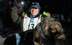 Erin Letzring celebrated with her lead dogs after she won the John Beargrease sled dog marathon by what organizers said was the smallest margins in hi