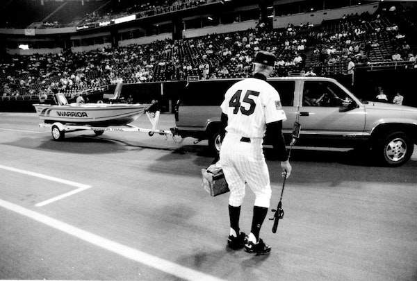 Twins players presented Wayne Terwilliger with a fishing boat at the Metrodome when he retired in 1994. Terwilliger died on Wednesday at 95.
