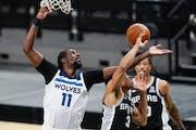 Minnesota Timberwolves center Naz Reid (11) shoots over San Antonio Spurs forward Keldon Johnson (3) during the second half of an NBA basketball game