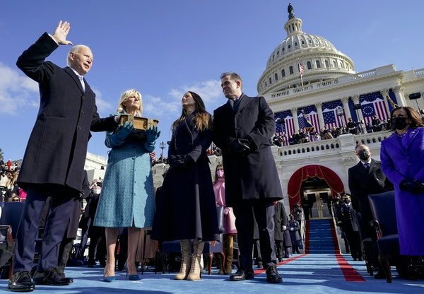From left, President Joe Biden is joined by his wife, Jill Biden; daughter Ashley Biden; and son Hunter Biden as he takes the oath of office at the U.