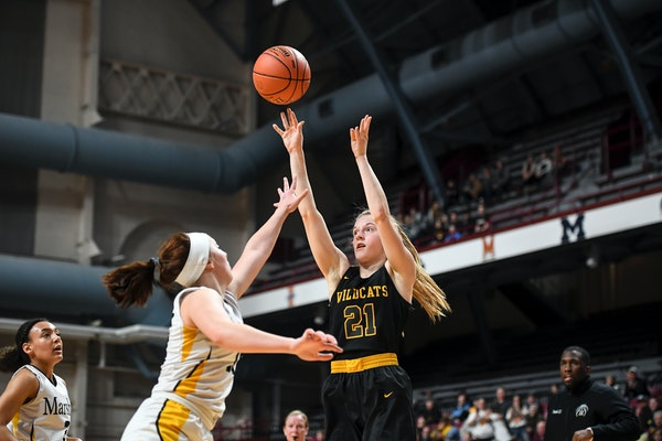 New London-Spicer forward Emma Hanson (21) hit a basket in a quarterfinal game last March at Maturi Pavilion. This year's quarterfinals will be play