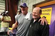 Brett Favre and Vikings coach Brad Childress were all smiles after Favre's first day of practice in 2010.