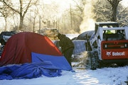 What could be the last formal homeless encampment in the city, located in Minnehaha Park,  was cleared by the Park Board Tuesday in Minneapolis .  ]DA